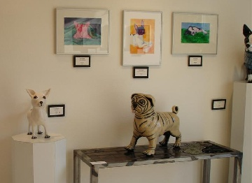 My work on the wall, my brother's work on the pedestal and table